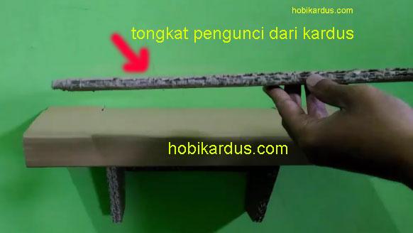 tongkat pengunci rak dinding